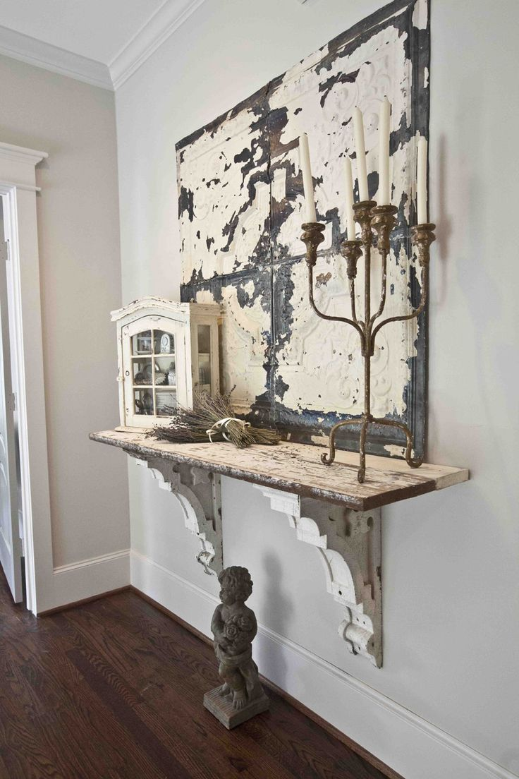 The shelf would be nicer in a warm honey oak finish. Love the antique corbels
