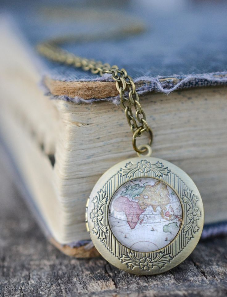 This 30 inch bronze chain necklace features a 32 mm photo locket that can hold two 24mm (roughly 1 inch) photos. The locket is adorned with a beautiful high quality vintage map print sealed behind a 2