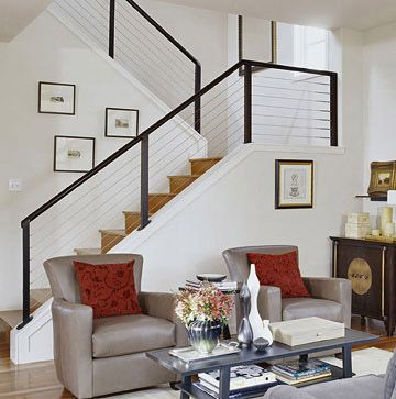 Cable railing with black (or charcoal) colored  posts/rail. Material: wood or metal? (I like this configuration: posts and top rail same color, sitting on top of stair tread.)