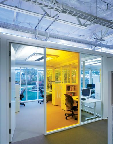 Glass walls for office. Sight lines through office to exterior.
