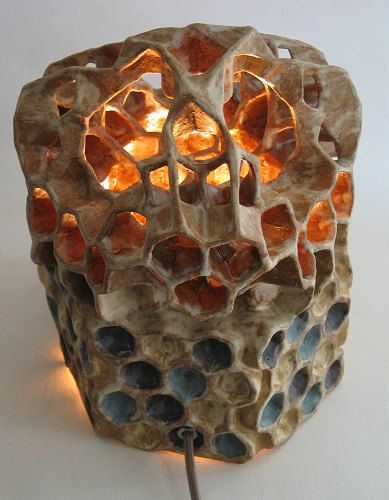 By Etsy artist Paul Distelzweig. This free standing light sculpture stands 10.5 inches high with an 8 inch hexagonal footprint. The name Apis habilis is a combination of the species name for the honey bee (Apis mellifera) and the first tool using hominid (Homo habilis). Honey bees have a long association with humans and were brought wherever humans migrated. This complex relationship provides a starting point for the creation of the Apis habilis pieces.