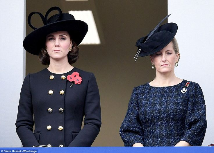 The Duchess of Cambridge looked sombre as she stood next to Sophie, Countess of Wessex, on the Foreign Office balcony