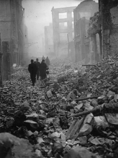 Londoners passing through the ruins of collapsed buildings. The consequences of the raid by German aircraft at London on December 31, 1940. S)