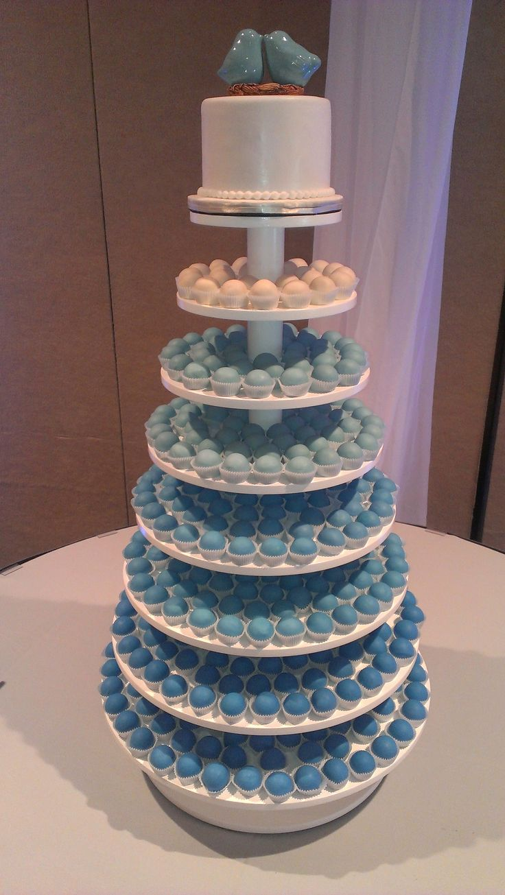 Check out our blog post on blue ombre weddings from the summer!  #cakeballs #weddingcake