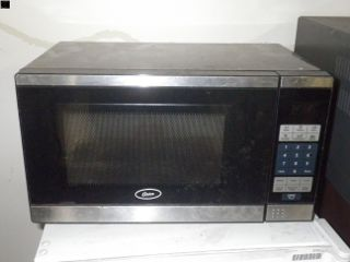 OSTER MICROWAVE For more information visit www.CalAuction.com