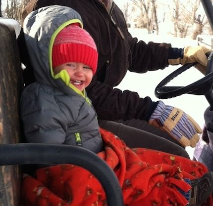 """Colby Bingham of Utah Dad wrote, """"It's my son & I plowing snow. In addition to the cute little boy, I couldn't help but notice my beautiful new pair of Kincos."""" Mom wrote, """"Plowing snow with Dad in freezing temps = ultimate joy for this little dude!"""""""