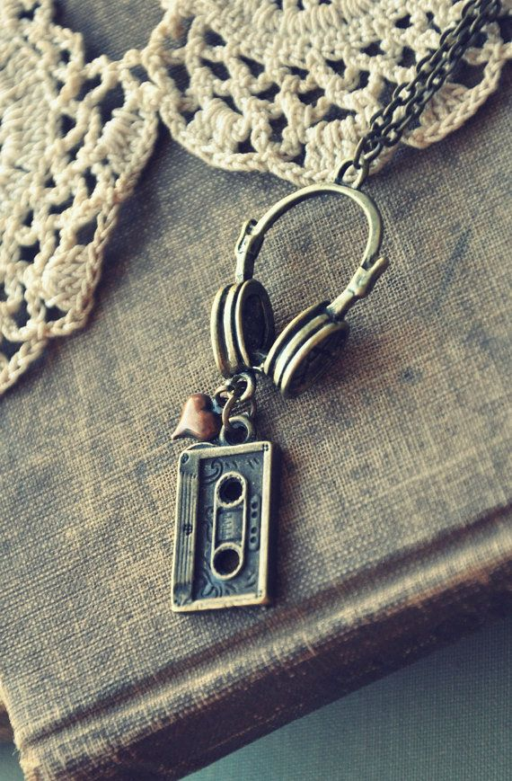 Cute - old school music necklace. #jewelry #headphones #cassette http://www.pinterest.com/TheHitman14/music-paraphenalia/