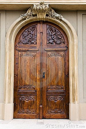 Wooden door of a church by Puma330, via Dreamstime