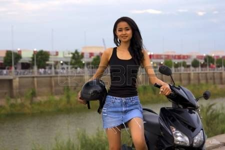 sexy asian girl with mini skirt, helmet, motorcycle in cambodia photo