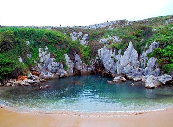 Landlocked Gulpiyuri Beach in Spain: http://beachblissliving.com/best-most-unique-beaches-in-the-world/