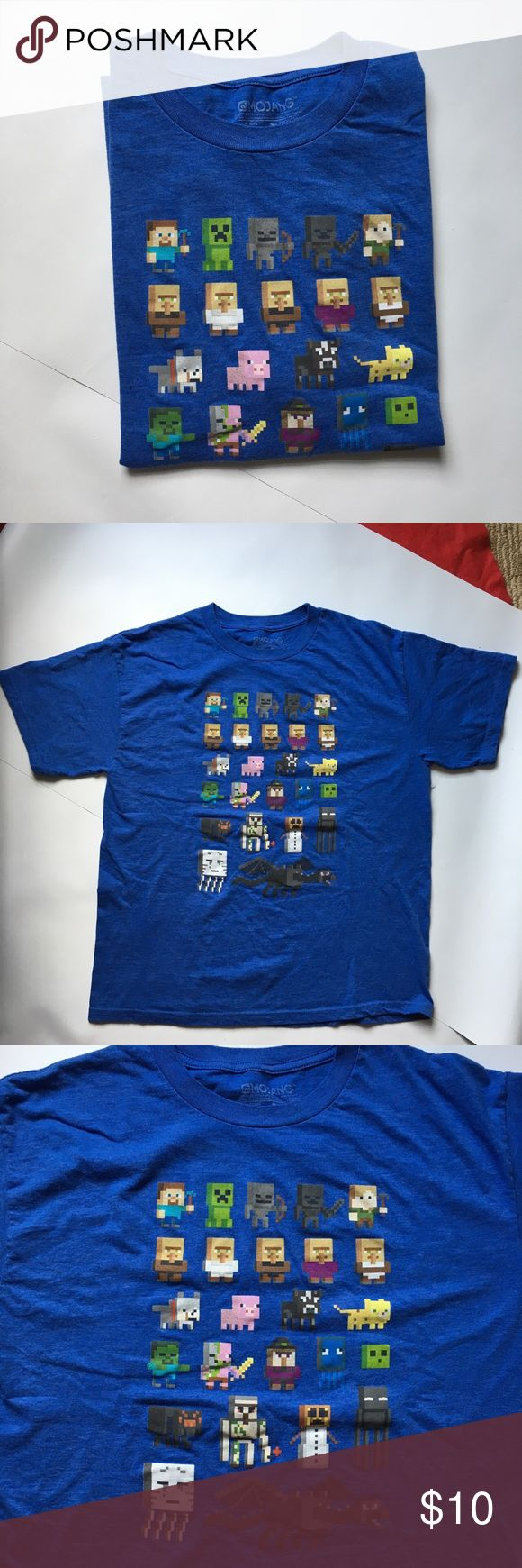 "Mojang Minecraft T-Shirt Size 2X (18) Blue Cotton Mojang Minecraft Boy's Short Sleeve Shirt Size 2X (18) Blue Cotton JINX -----MOJANG MINECRAFT  DESIGN BY JINX  Size: 2X (18) Color: Blue  Measurements Laying Flat: Approx. Full Chest: Armpit to Armpit: 20"" Length: Shoulder to Hem: 25"" Armpit to Hem: 14.5""   Sleeve Opening: 8"" Sleeve Across: 9"" Sleeve Length: 8.5"" Shirts Tees - Short Sleeve"