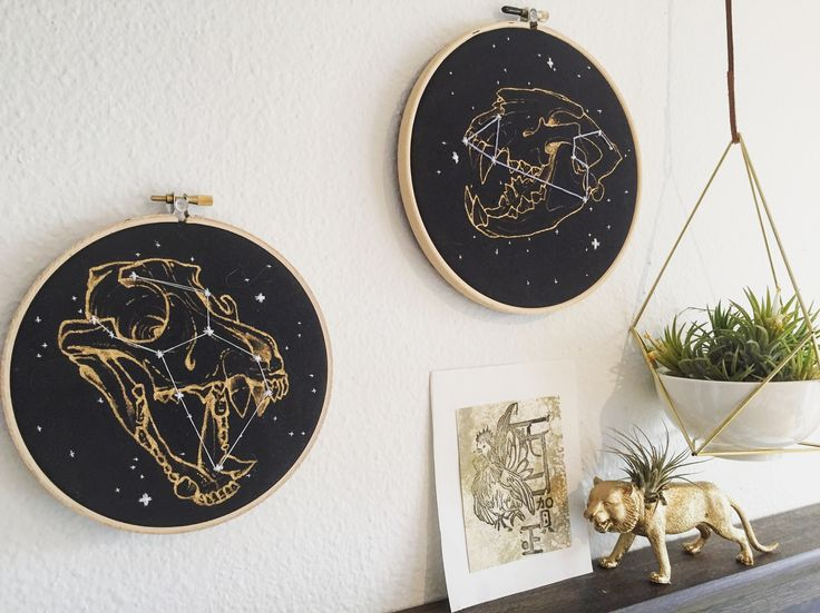 Wolf and lion skulls painted in gold on fabric with constellation embroidered details. Commissions accepted.