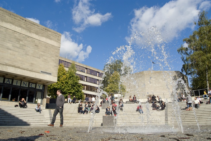 Students in The Square, the central meeting place at UEA