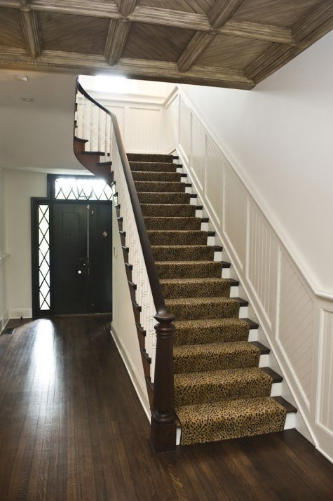 Wainscoting On The Walls, Dark Wood Floors, White Step Risers With Animal  Print Stairway