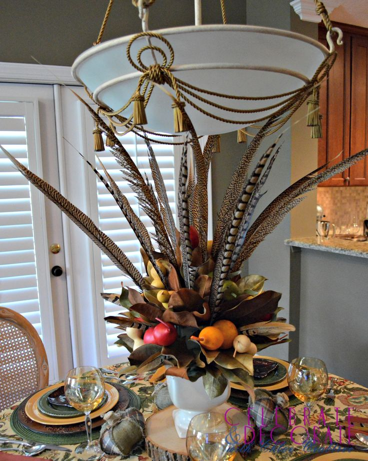 A Fall Centerpiece Of Magnolia Leaves And Feathers