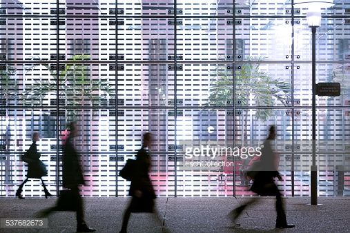 Stock Photo : Business people passing modern office building