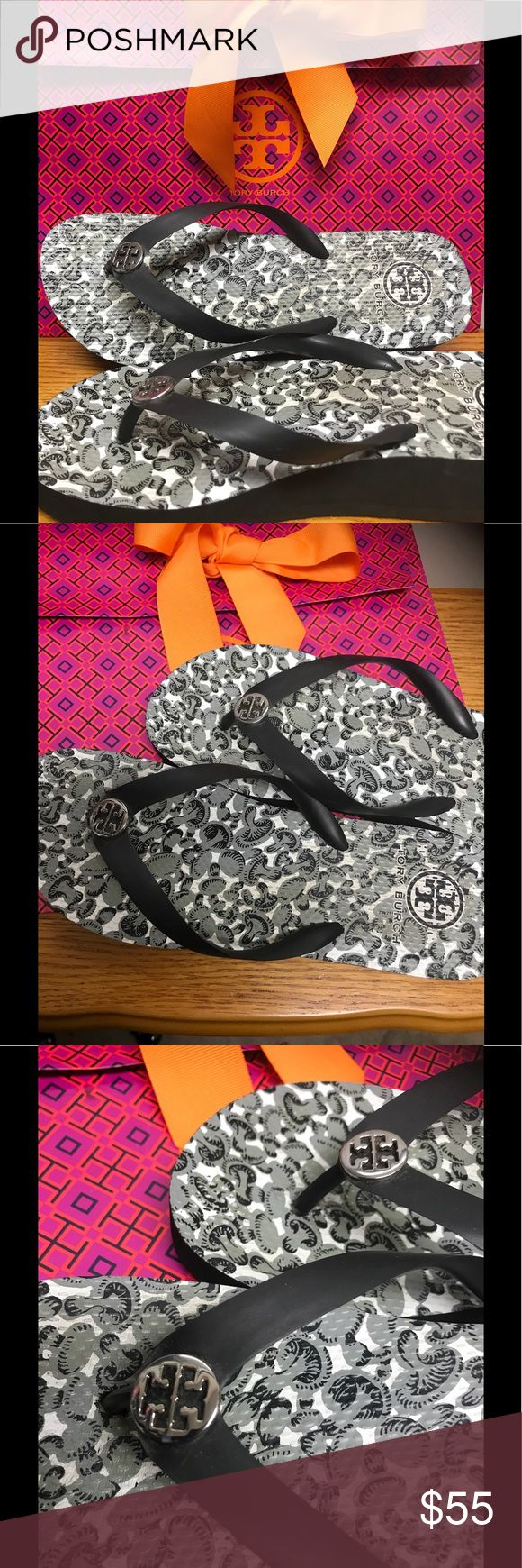 Tory Burch wedge flip flops. Black and white wedge flip flops.  Only worn a couple of times.  Bought another pair very similar.  Double T silver medallion. Tory Burch Shoes Sandals
