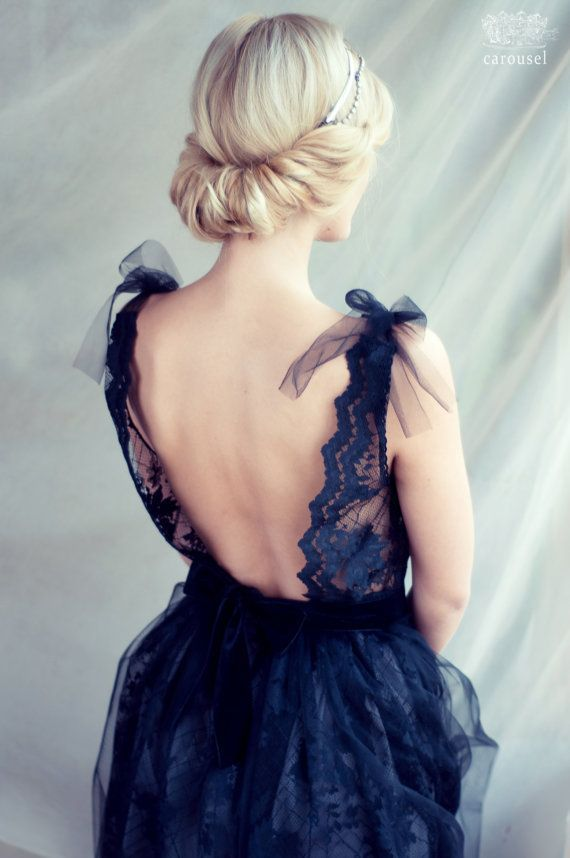 Black lace dress with opened back.