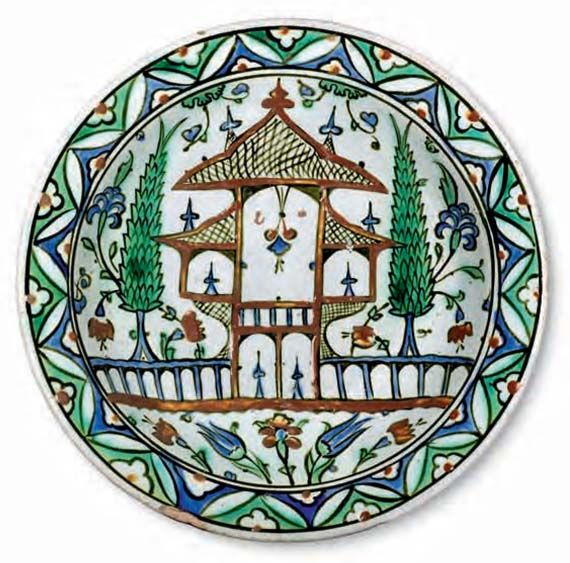 Dish with a representation of a garden / Turkey, Iznik, circa 1575 –1580 / Fritware, polychrome underglaze painted on an opaque white glaze, Ø 29.8 cm / Kindly lent by Princess Catherine Aga Khan