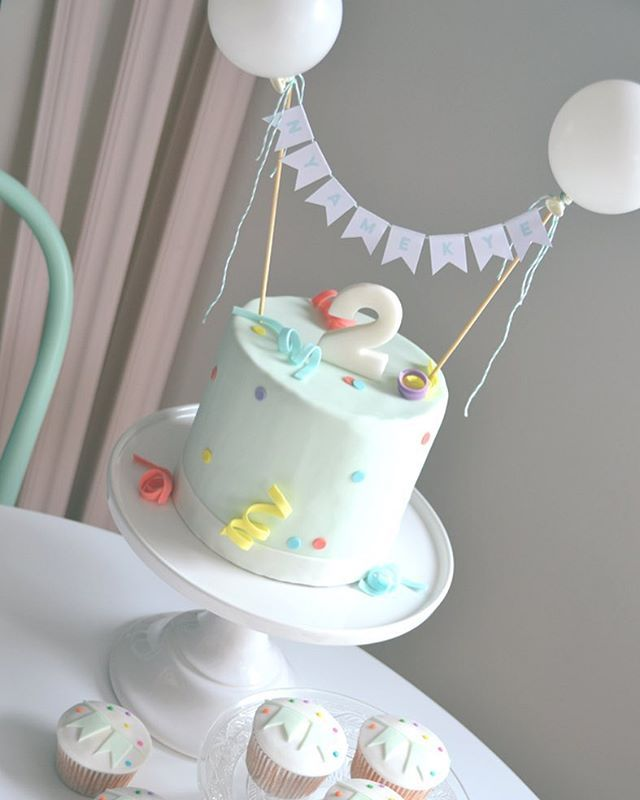 Happy #birthday little Nyamekye! #mysweetdear #birthdaycake #bunting #babyboy #boysparty #balloon #ballooncake #confetti #streamer #cupcakes #lovetobake #fondant