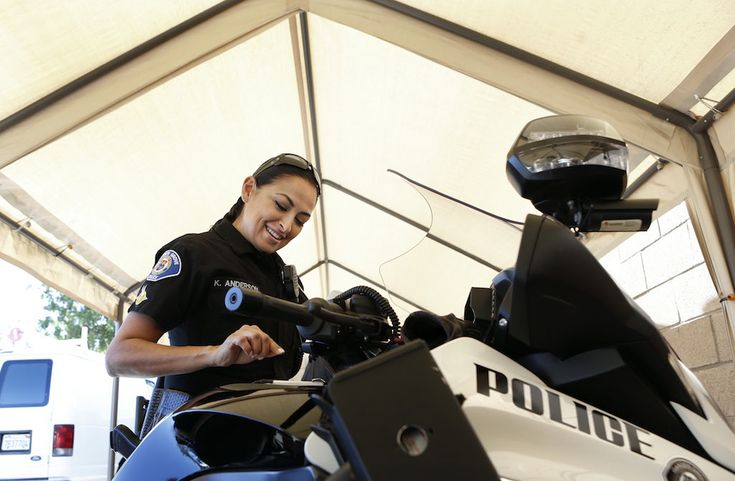 Garden Grove Police Department motorcycle officer Katherine Anderson gets ready for her shift. Photo by Christine Cotter