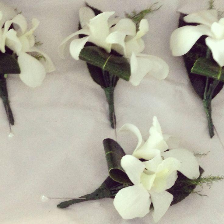 Little flower lane. Singapore orchid button holes.