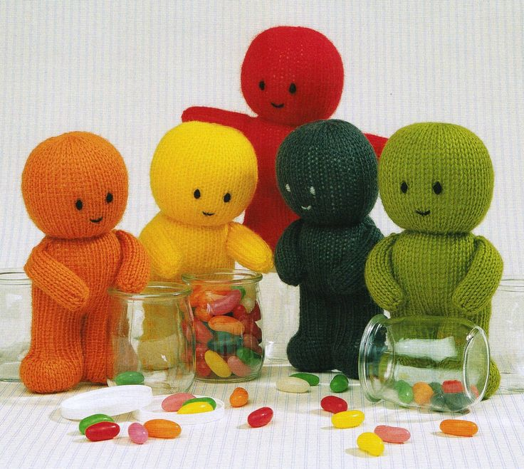 """From Jean Greenhowe's 'Little Gift Dolls' collection comes the (almost literally) sweet Jelly Babies. Perfect as a gift for a variety of occasions (birthday, get well, well done etc.) or just as cuddly toys. Knitted in DK wool they are quick and easy to make and are about 18cm/7"""" high. Designed and published by Jean Greenhowe Designs in 1989."""