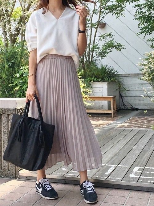 Cream button-down, pleated skirt, sneakers