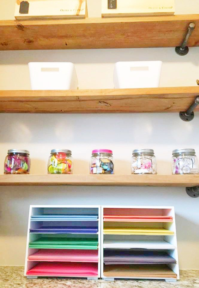 EH Design - Tiny Art Room with so much organization and cedar shelving, framed chalkboard, cork boards for kids art, etc.  - See through storage for little eyes to see and paper sorters for construction paper!