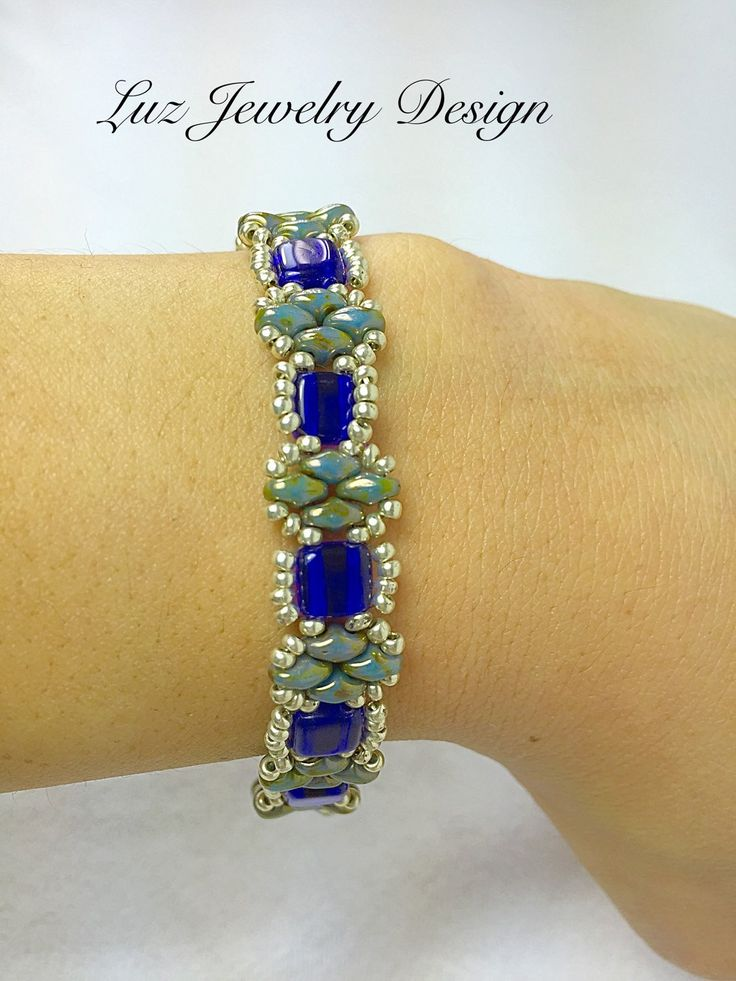 This beautiful handmade Beadwoven Bracelet, is made of Czech Mates glass beads 6mm cobalt two-hole tila bead and green super duo with blue and silver beads. Mea