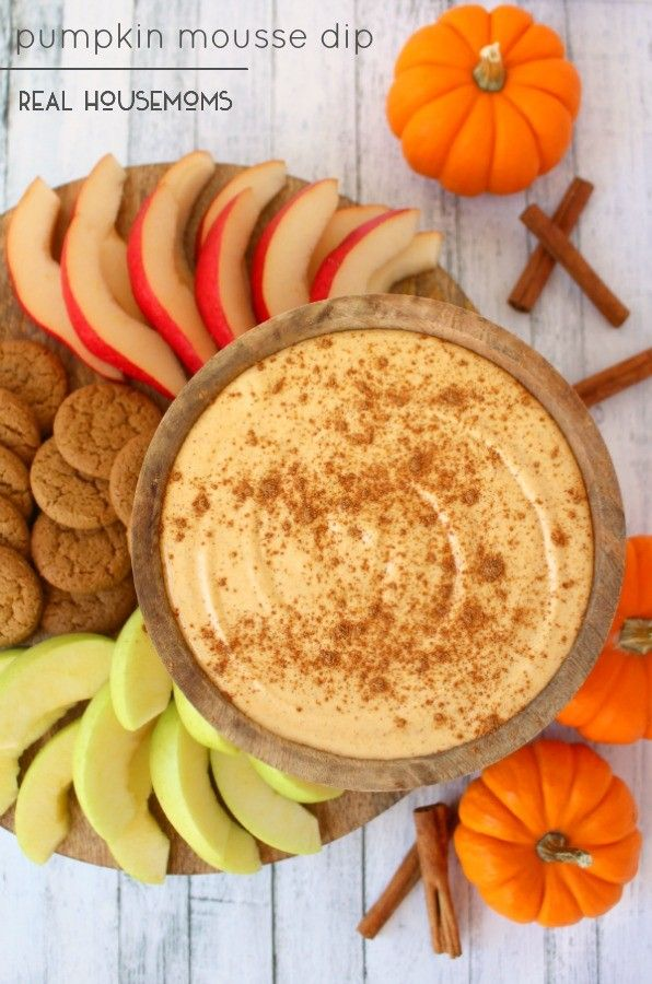 The perfect fall party appetizer, this sweet Pumpkin Mouse Dip is fantastic for any holiday, gathering or get-together! Served with pears, apples and gingersnap cookies, its a dip everyone will love!