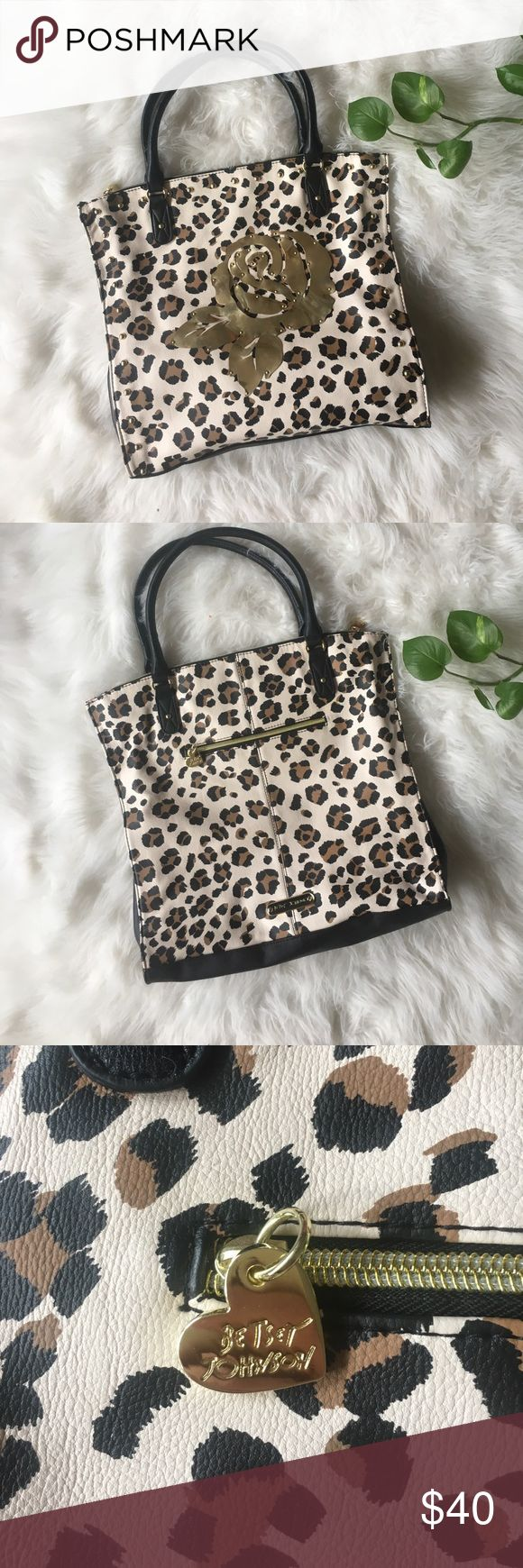 """Betsey Johnson clear to me tote bag Beautiful animal print tote bag with gold rose detail. Very spacious 15"""" by 17"""" tote with lots of pockets and compartments. Even a hook for your keys! Absolutely stuffing. Perfect inside and out, has never been used. From a smoke free home. Betsey Johnson Bags Totes"""