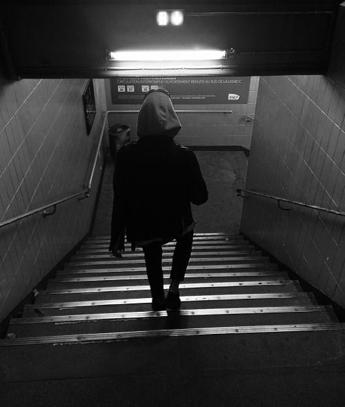 He walked down the dark damp steps to the subway. That was where they were keeping her.