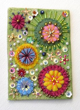 Mixed media fabric postcard...with sequins and beads............Pretty !