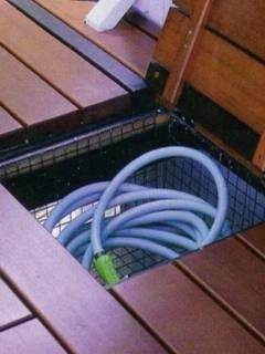 deck org- Add a wire basket under you deck for additional outdoor storage space. What a great way to hide garden hoses, outdoor dog toys, or sport equipment.