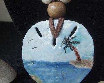 Acrylic hand painted beach scene on natural sand dollar. ...