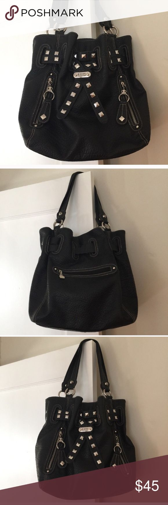 """Kathy Van Zeeland Large Black Bag Kathy Van Zeeland Large Black Bag - Shoulder strap with 11"""" drop and silver colored hardware - Top of Bag has magnetic closure - Interior features three compartments, one name/logo patch, 4 pockets and one with zipper.   - Exterior feature three zippered pockets. - Approx. 12""""H x 14""""W x 5""""D -Soft bag in like new condition. •••FIRM PRICE••• Kathy Van Zeeland Bags Shoulder Bags"""