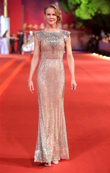 The nude crystal-embellished gown from Dolce & Gabbana's fall 2007 collection may have appeared heavy, but Nicole Kidman's shimmering frock had an airy feeling as she walked the red carpet at the opening ceremonies of the 17th Shanghai International Film Festival in China on June 14, 2014.