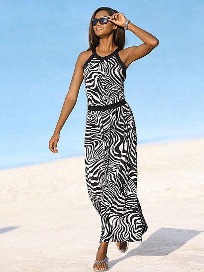 Das Jerseykleid von ALBA MODA setzt mit seinem schwarz-weißen Zebradruck und den schwarzen Blenden ganz auf starke modische Kontraste