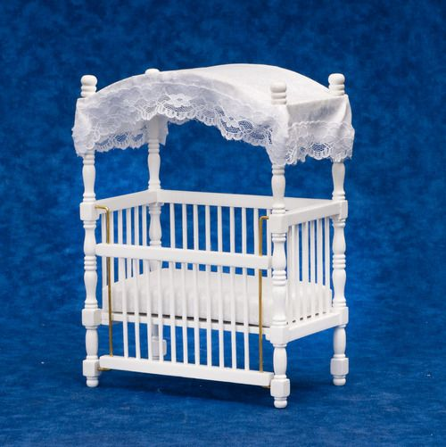 "Canopy Crib - White - Canopy Crib, White   This White Canopy Crib is 1/12th scale and measures 4-5/8""W x 6-5/16""H x 2-11/16""D.  The White Canopy Crib will look lovely in your dollhouse nursery and has one adjustable side."