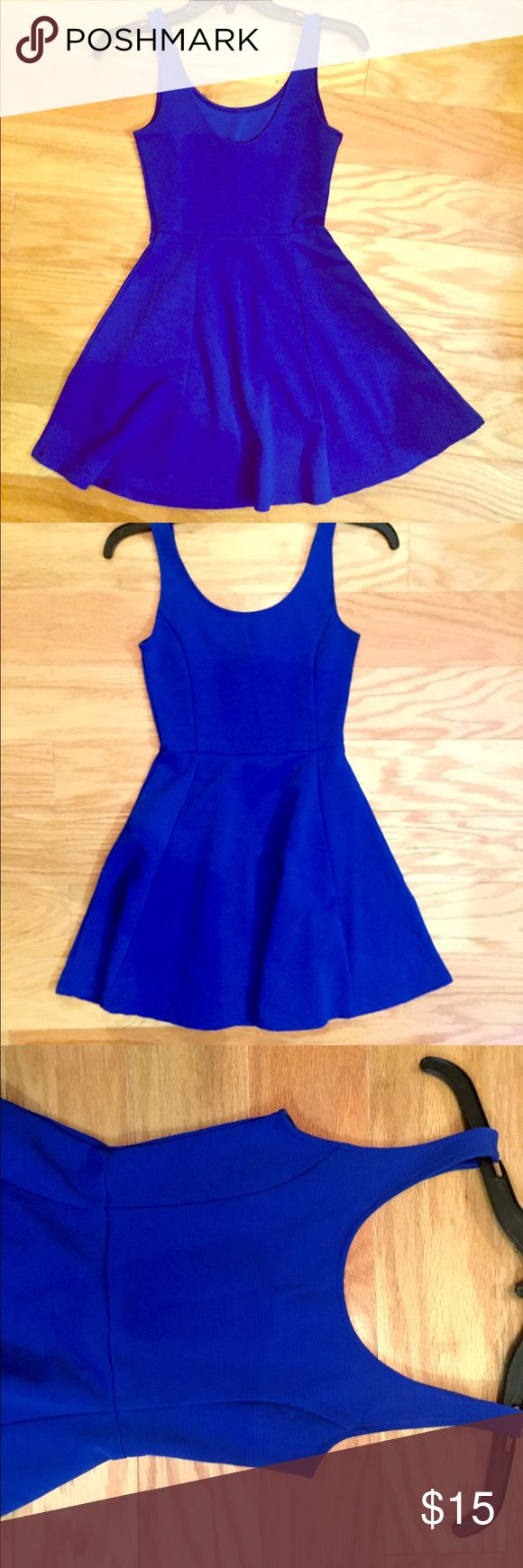 "H&M Royal Blue Skater Dress Great color! Lightly worn, no flaws. Material is textured and gives for a more ""quality"" look. Flattering fit. Tag says size 2. Small. Not really short enough to be a mini dress, its shorter but a good length. Last photo is of the back, it drops down a little bit lower than the neckline does in front Divided Dresses Mini"