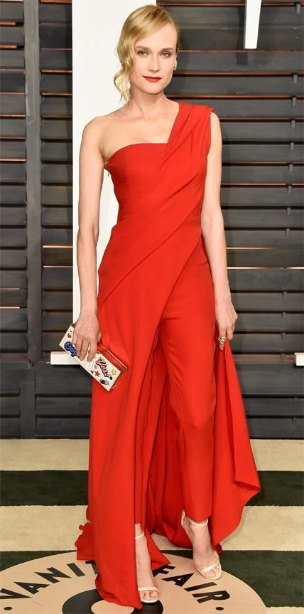 Look of the Day - February 23, 2015 - Diane Kruger in Donna Karan Atelier from #InStyle Fashion's favorite star Diane Kruger made a statement at the Vanity Fair Oscars after-party in a red silk crepe draped one-shoulder Donna Karan Atelier gown with a wide side slit that revealed matching cigarette pants. The finishing touches? H. Stern jewelry, a playful sticker Anya Hindmarch clutch, and delicate pale sandals.