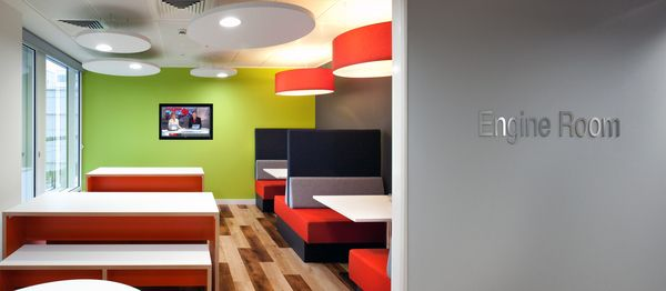"""Bright colours, seating booths and flat screen display make a great """"engine room"""" to take a break away from your desk"""