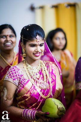 South Indian Bride - Vasu & Ramya wedding story | WedMeGood | Bride in a Purple and Gold Saree with Gold Layered Jewelry #wedmegood #indianbride #southindianbride #kanjivaram #purple #gold #saree