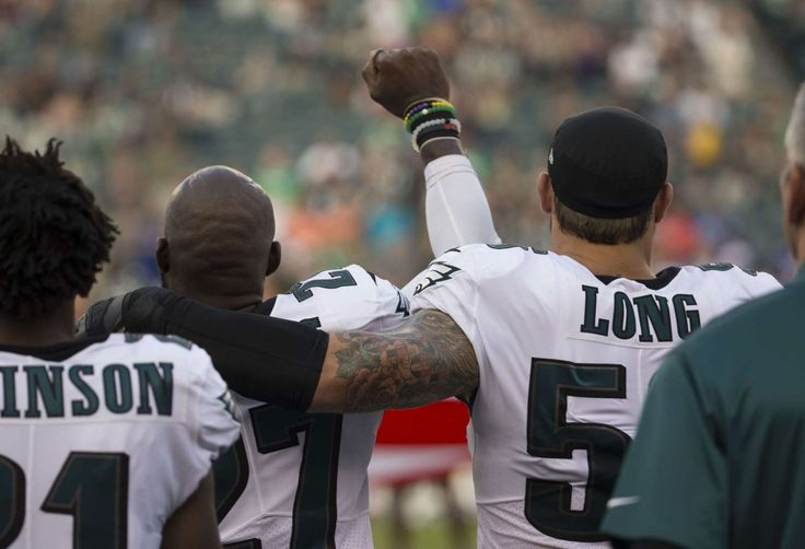 NFL players' national anthem protests   -  Malcolm Jenkins of the Philadelphia Eagles holds his fist in the air while Chris Long of the Philadelphia Eagles puts his arm around him during the national anthem prior to the preseason game against the Buffalo Bills at Lincoln Financial Field on August 17, 2017 in Philadelphia, Pennsylvania.