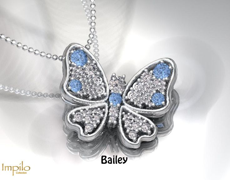 """""""Bailey"""" - Beautiful butterfly with five aquamarine gemstones evenly spread out with small round brilliant cut diamonds."""