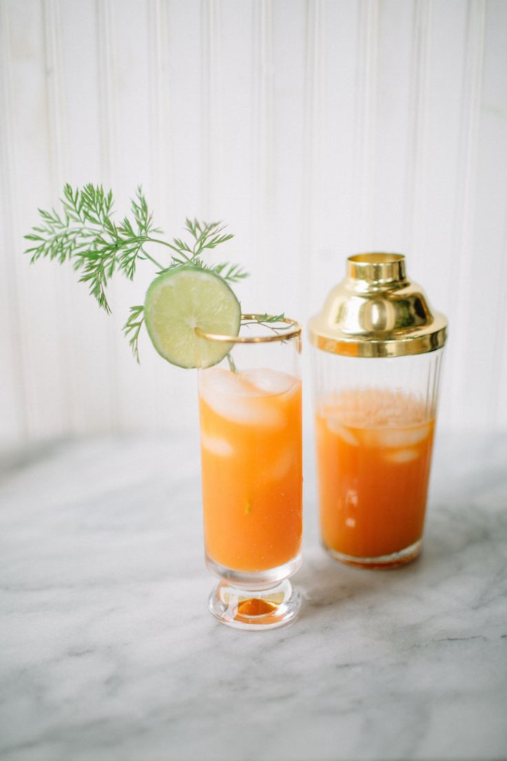 Carrot Ginger Cocktail - Coconut Rum, Silver Rum, Carrot Juice, Lime Juice, Simple Syrup, Ginger.