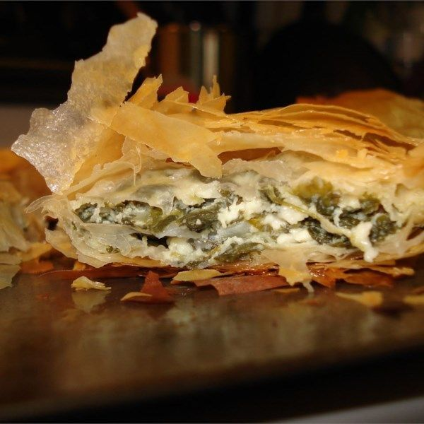 """Spanakopita II   """"The recipe for these spinach and feta appetizer triangles came from a Greek family friend. They may be frozen prior to baking."""" #recipe #newyearseve #holidays #appetizer"""