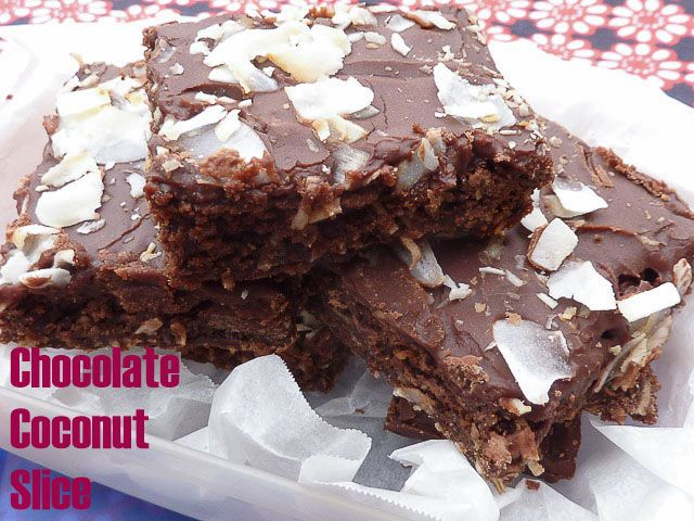 Chocolate Coconut Slice squares of baked, chewy chocolate slice topped with coconut