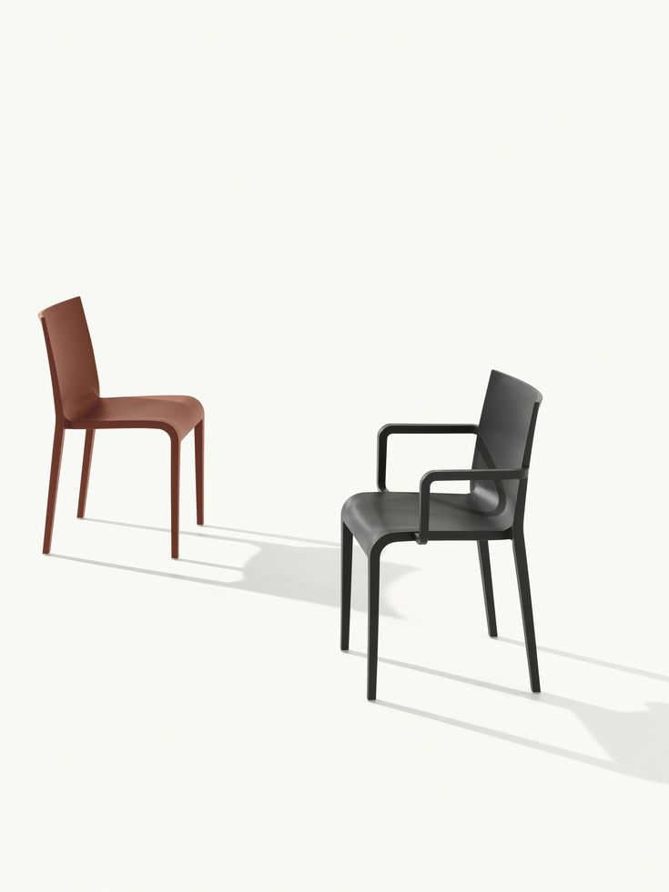 Nassau 1.0 (Red) and Nassau 2.0 (Black). Stacking chair/armchair in air-molded polypropylene, designed by Marc Sadler for Sandler Seating's Metalmobil collection.